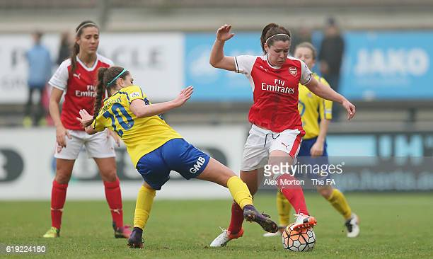 Emma Mitchell of Arsenal and Carla Humphrey of Doncaster during the WSL 1 match between Arsenal Ladies FC and Doncaster Rovers Belles at Meadow Park...