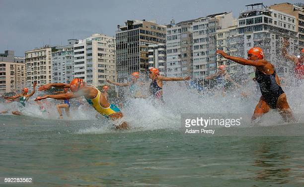 Emma Moffatt of Australia and Andrea Hewitt of New Zealand race into the water during the Women's Triathlon on Day 15 of the Rio 2016 Olympic Games...