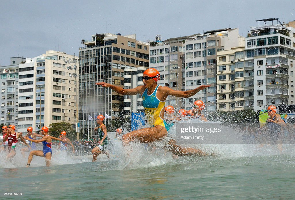 Emma Moffatt of Australia (52) races into the water during the Women's Triathlon on Day 15 of the Rio 2016 Olympic Games at Fort Copacabana on August 20, 2016 in Rio de Janeiro, Brazil.