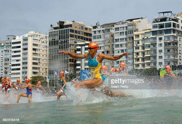Emma Moffatt of Australia races into the water during the Women's Triathlon on Day 15 of the Rio 2016 Olympic Games at Fort Copacabana on August 20...
