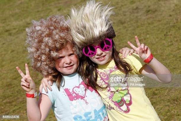 Emma Murphy and Cerys Hayes from Wexford outside the free family wash centre operated by Hotpoint in the family campsite at the Electric Picnic...