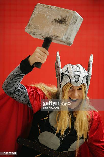 Emma O'Neil from Belfast poses as Thor ahead of the MCM London Comic Con Expo at ExCel on October 26 2012 in London England Visitors to the Comic...
