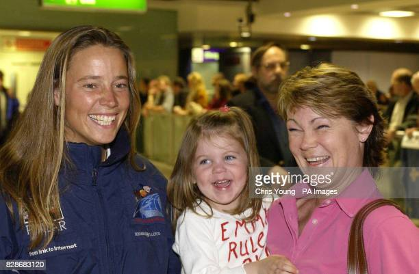 Emma Richards from the Isle of Wight is welcomed by fellow yachtswoman Tracy Edwards and her threeyearold daughter Mackenna at London s Heathrow...