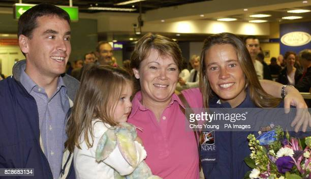 Emma Richards from the Isle of Wight is welcomed by her brother David and fellow yachtswoman Tracy Edwards and her threeyearold daughter Mackenna at...