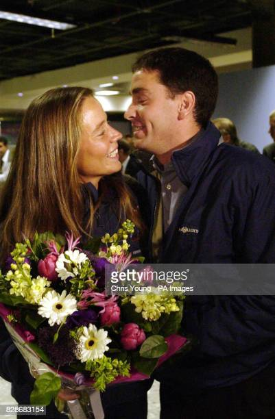 Emma Richards from the Isle of Wight is welcomed by ber brother David at London s Heathrow Airport as she returns to the UK after becoming the first...