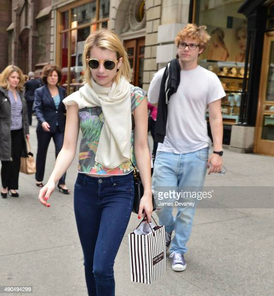 Emma Roberts and Evan Peters leave Henri Bendel on May 14 2014 in New York City