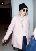 Emma Roberts and Evan Peters seen at LAX on May 09 2014 in Los Angeles California