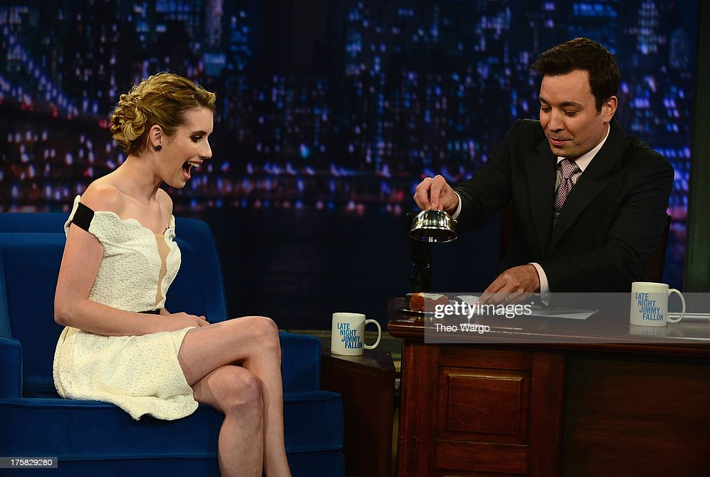 <a gi-track='captionPersonalityLinkClicked' href=/galleries/search?phrase=Emma+Roberts&family=editorial&specificpeople=226535 ng-click='$event.stopPropagation()'>Emma Roberts</a> and Jimmy Fallon during a taping of 'Late Night With Jimmy Fallon'>> at Rockefeller Center on August 8, 2013 in New York City.