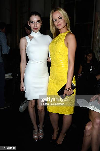 Emma Roberts and Mena Suvari attend the Versace show as part of Paris Fashion Week HauteCouture Fall/Winter 20132014 at on June 30 2013 in Paris...