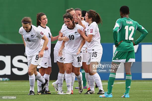 Emma Rolston of New Zealand celebrates her team's first goal with team mates after the FIFA U20 Women's World Cup Canada 2014 Quarter Final match...