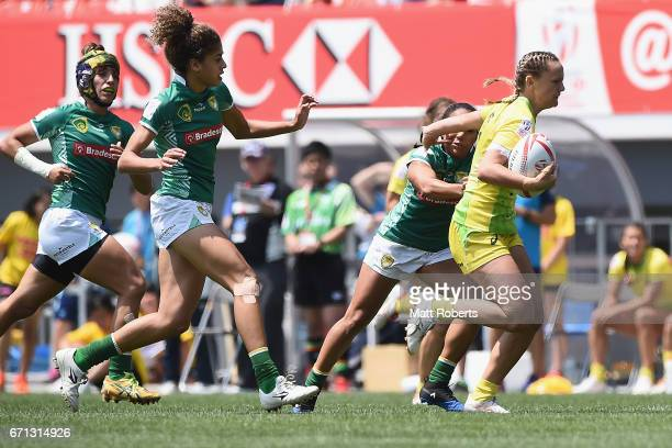 Emma Skyes of Australia takes on the defence during the HSBC World Rugby Women's Sevens Series 2016/17 Kitakyushu pool match between Australia and...