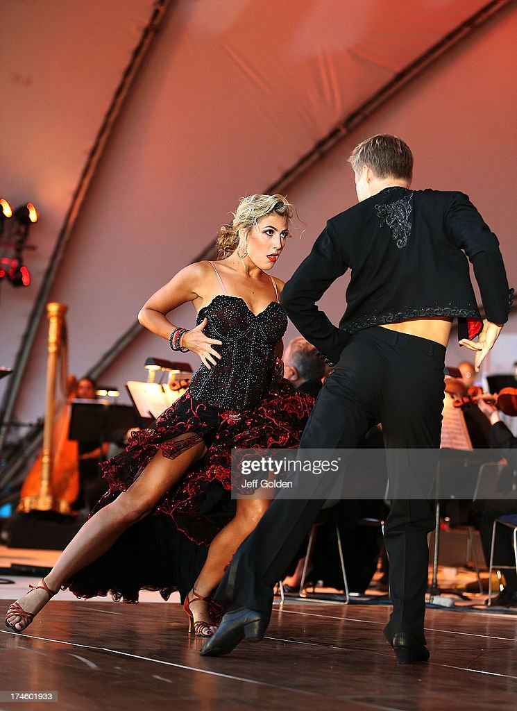 Emma Slater dances with partner <a gi-track='captionPersonalityLinkClicked' href=/galleries/search?phrase=Derek+Hough&family=editorial&specificpeople=4532214 ng-click='$event.stopPropagation()'>Derek Hough</a> during the California Philharmonic Festival on the Green at Santa Anita Race Track on July 27, 2013 in Arcadia, California.