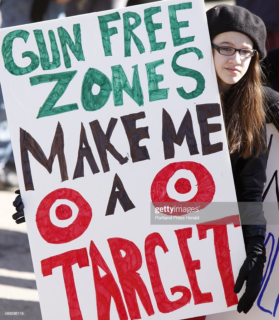 Emma Solorzano, 13, of Jefferson, holds a sign saying Gun Free Zones Make Me a Target at a rally protesting gun control legislation and supporting gun rights in Wiscasset on Saturday, March 9, 2013, About 175 people attended the rally, which was organized by Jessica Beckwith of Lewiston, who is forming the Maine Gun Rights Coalition.