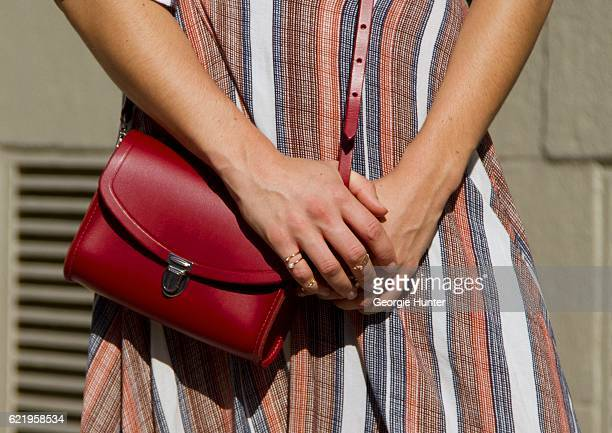 Emma Sousa wearing rayon red white and blue striped Just Female midi wrap dress with waist tie and three quarter length sleeves The Cambridge Satchel...
