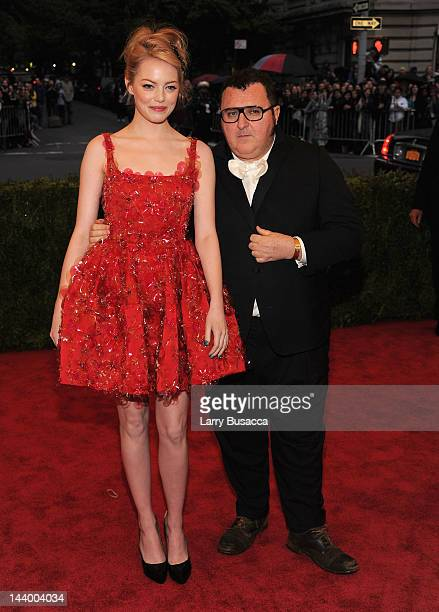 Emma Stone and Alber Elbaz attend the 'Schiaparelli And Prada Impossible Conversations' Costume Institute Gala at the Metropolitan Museum of Art on...