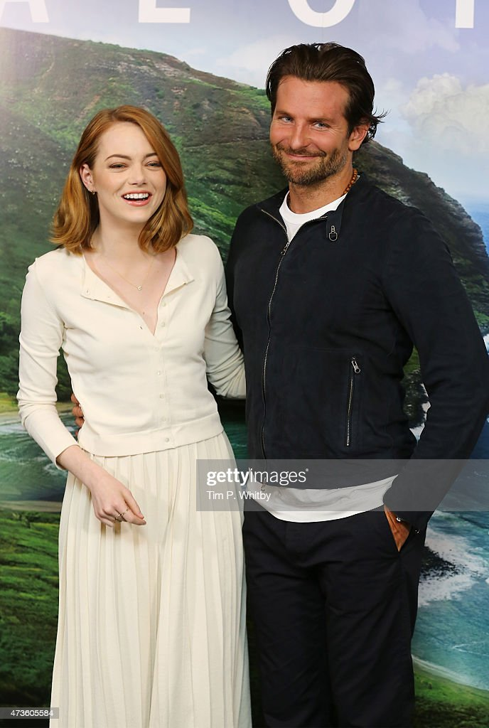 Emma Stone and Bradley Cooper attend a photocall for 'Aloha' at Soho Hotel on May 16, 2015 in London, England.