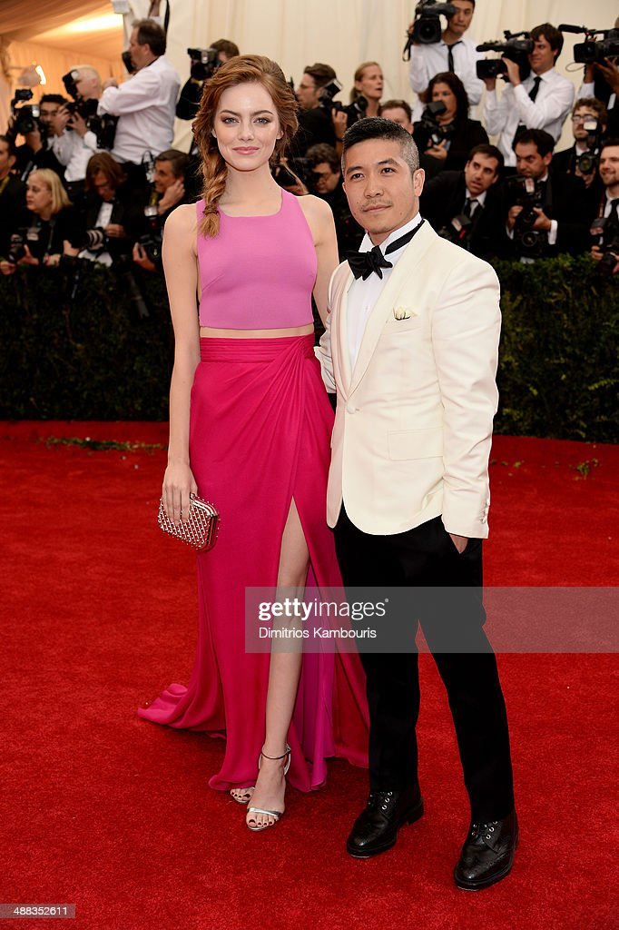 Emma Stone and designer Thakoon Panichgul attend the 'Charles James: Beyond Fashion' Costume Institute Gala at the Metropolitan Museum of Art on May 5, 2014 in New York City.