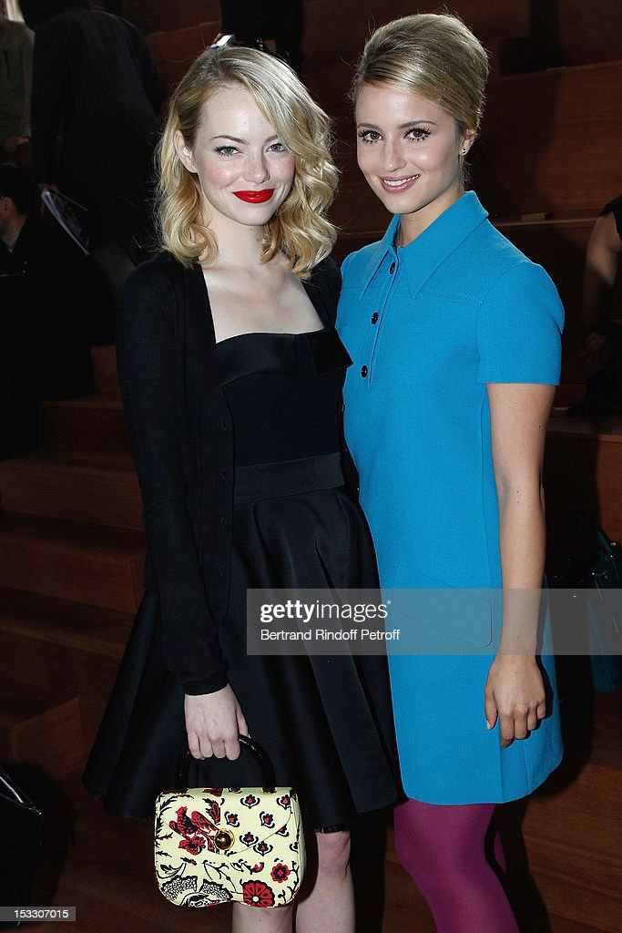Emma Stone and Dianna Agron attend the Miu Miu Spring/Summer 2013 show as part of Paris Fashion Week on October 3, 2012 in Paris, France.