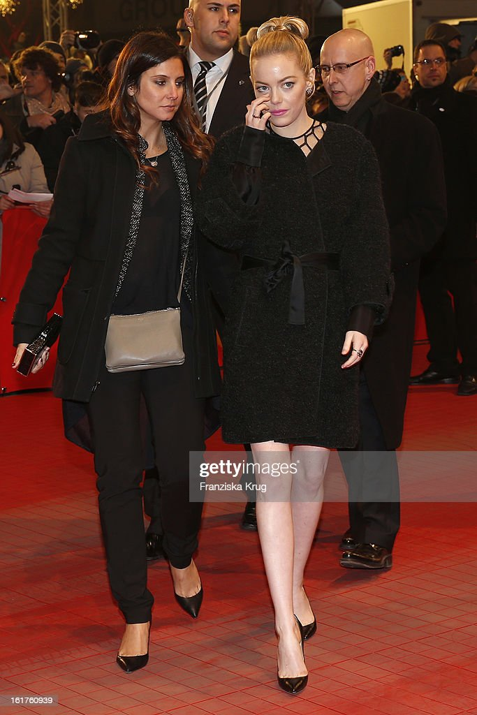 Emma Stone and guest attend 'The Croods' Premiere - BMW at the 63rd Berlinale International Film Festival at Berlinale Palast on February 15, 2013 in Berlin, Germany.