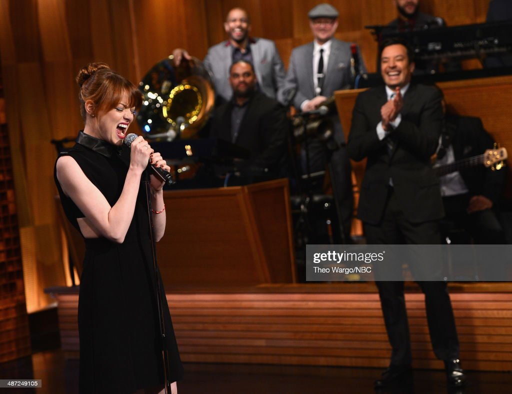 Emma Stone and Jimmy Fallon have a 'Lip Sync Battle' during a taping of 'The Tonight Show Starring Jimmy Fallon' at Rockefeller Center on April 28, 2014 in New York City.