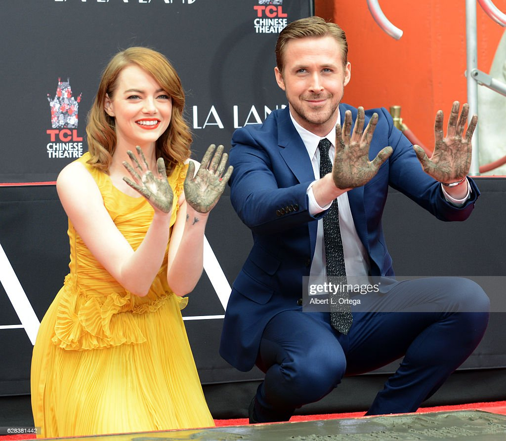 Emma Stone and Ryan Gosling attend their hand and footprint ceremony held at TCL Chinese Theatre IMAX on December 7, 2016 in Hollywood, California.