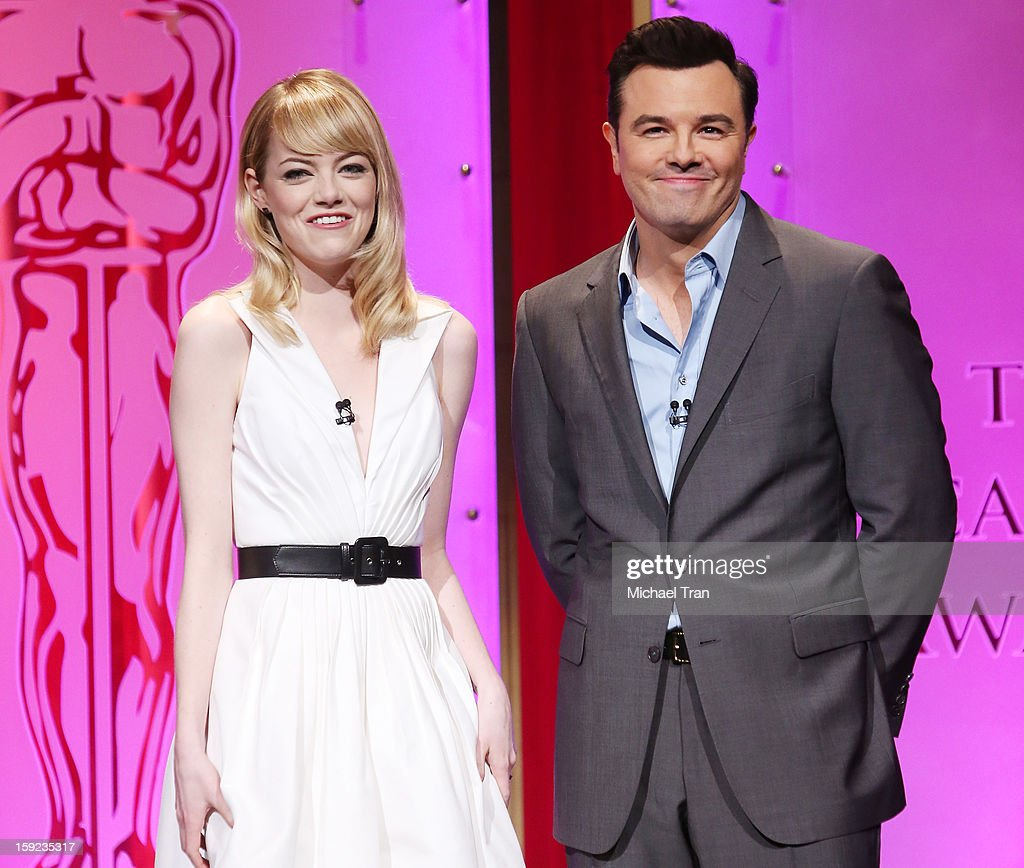 Emma Stone (L) and Seth MacFarlane speak at the 85th Academy Awards nominations announcement held at AMPAS Samuel Goldwyn Theater on January 10, 2013 in Beverly Hills, California.