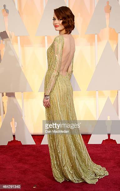 Emma Stone arrives at the 87th Annual Academy Awards at Hollywood Highland Center on February 22 2015 in Los Angeles California