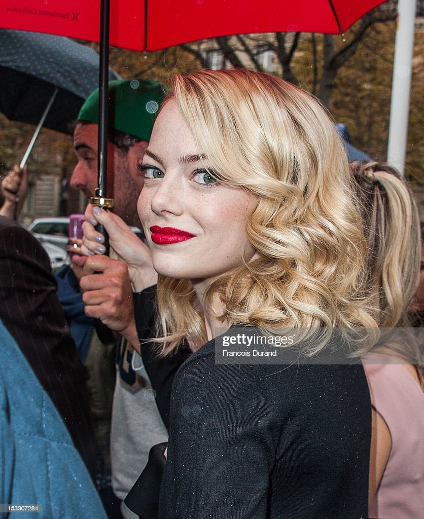 <a gi-track='captionPersonalityLinkClicked' href=/galleries/search?phrase=Emma+Stone&family=editorial&specificpeople=672023 ng-click='$event.stopPropagation()'>Emma Stone</a> arrives at the Miu Miu Spring/Summer 2013 show as part of Paris Fashion Week on October 3, 2012 in Paris, France.