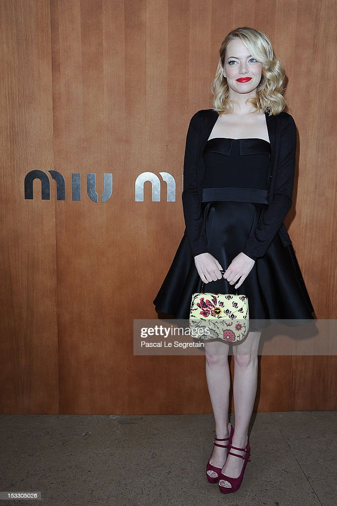 <a gi-track='captionPersonalityLinkClicked' href=/galleries/search?phrase=Emma+Stone&family=editorial&specificpeople=672023 ng-click='$event.stopPropagation()'>Emma Stone</a> attends the Miu Miu Spring/Summer 2013 show as part of Paris Fashion Week on October 3, 2012 in Paris, France.