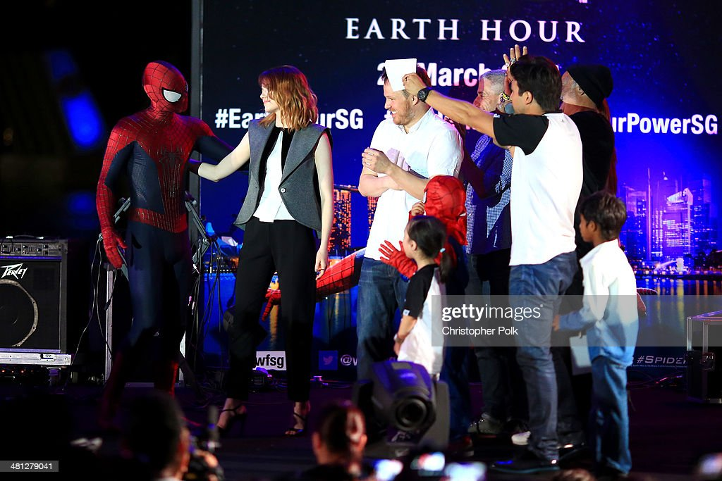 <a gi-track='captionPersonalityLinkClicked' href=/galleries/search?phrase=Emma+Stone&family=editorial&specificpeople=672023 ng-click='$event.stopPropagation()'>Emma Stone</a> of 'The Amazing Spider-Man 2' greets Spider-Man as he joins the stage for the Earth Hour Kick-Off with Spider-Man, The First Super Hero Ambassador for Earth Hour, the global movement organized By WWF (World Wide Fund For Nature) on March 29, 2014 in Singapore. #spiderman