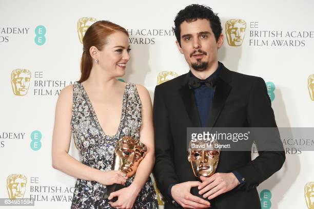Emma Stone winner of the Best Actress Award for 'La La Land' and Damien Chazelle winner of Best Director for 'La La Land' poses in the winners room...