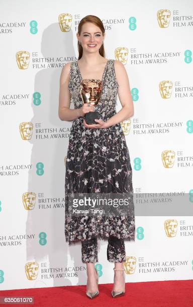 Emma Stone winner of the Best Actress Award for 'La La Land' poses in the winners room at the 70th EE British Academy Film Awards at the Royal Albert...