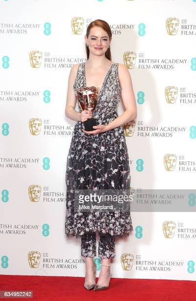 Emma Stone with her Best Actress award for La La Land poses in the winners room at the 70th EE British Academy Film Awards at Royal Albert Hall on...