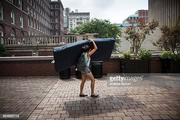 Emma Sulkowicz a senior visual arts student at Columbia University carries a mattress in protest of the university's lack of action after she...