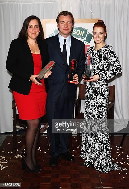 Emma Thomas Christopher Nolan and Jessica Chastain at the Jameson Empire Awards 2015 at the Grosvenor House Hotel on March 29 2015 in London England