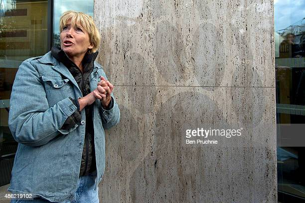 Emma Thompson places a giant paw sticker on the outside of the Shell Building on September 2 2015 in London England The sticker contains the names of...