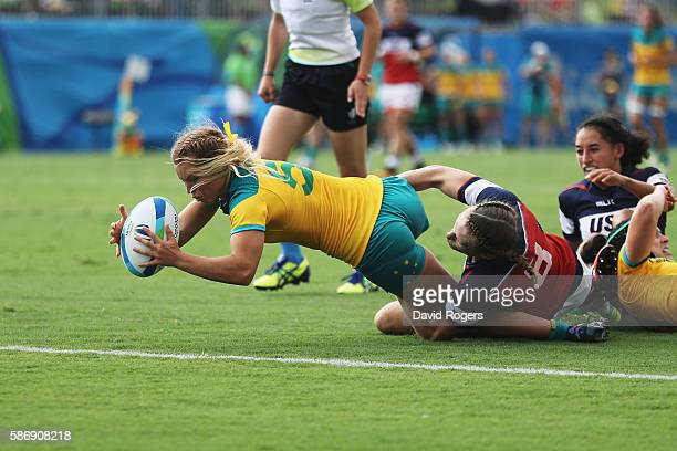 Emma Tonegato of Australia dives to score the try against Carmen Farmer of the United States during the Women's Pool A rugby match on Day 2 of the...