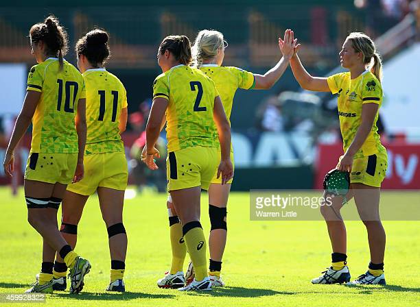 Emma Tonegato of Australia is congratulated by her team mates after the game against France during the IRB Women's Sevens Rugby World Series at the...