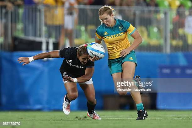 Emma Tonegato of Australia is tackled by Kayla Mcalsietr of New Zealand during the Women's Gold Medal Rugby Sevens match between Australia and New...