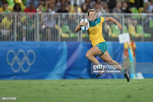 Emma Tonegato of Australia on her way to scores a try during the Women's Gold Medal Rugby Sevens match between Australia and New Zealand on Day 3 of...