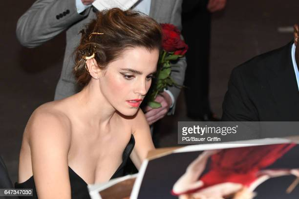 Emma Watson is seen signing autographs for fans as she arrives at the premiere of 'Beauty and the Beast' on March 02 2017 in Los Angeles California