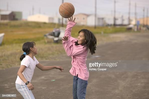 Emma Weyiouanna and Eva Johnson Inuit girls playing basketball on the Island of Shishmaref Chukchi Sea Alaska The future is bleak for these children...