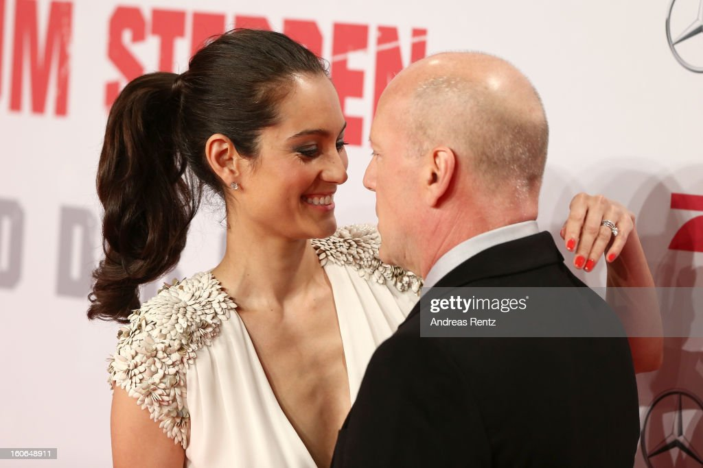 Emma Willis and <a gi-track='captionPersonalityLinkClicked' href=/galleries/search?phrase=Bruce+Willis&family=editorial&specificpeople=202185 ng-click='$event.stopPropagation()'>Bruce Willis</a> attend 'Die Hard - Ein Guter Tag Zum Sterben' Germany Premiere at Cinestar Potsdamer Platz on February 4, 2013 in Berlin, Germany.