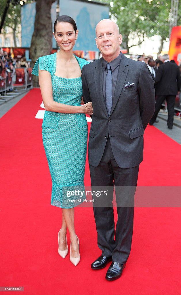 Emma Willis (L) and <a gi-track='captionPersonalityLinkClicked' href=/galleries/search?phrase=Bruce+Willis&family=editorial&specificpeople=202185 ng-click='$event.stopPropagation()'>Bruce Willis</a> attend the European Premiere of 'Red 2' at the Empire Leicester Square on July 22, 2013 in London, England.
