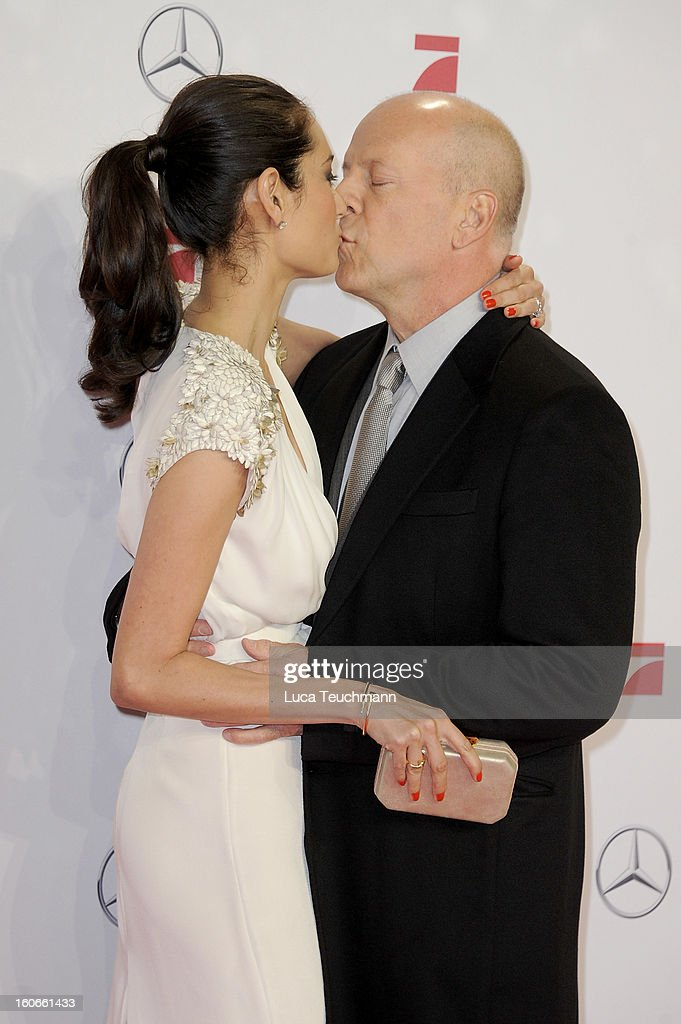 Emma Willis and Bruce Willis attend the premiere of 'Die Hard - Ein Guter Tag Zum Sterben' at Sony Center on February 4, 2013 in Berlin, Germany.