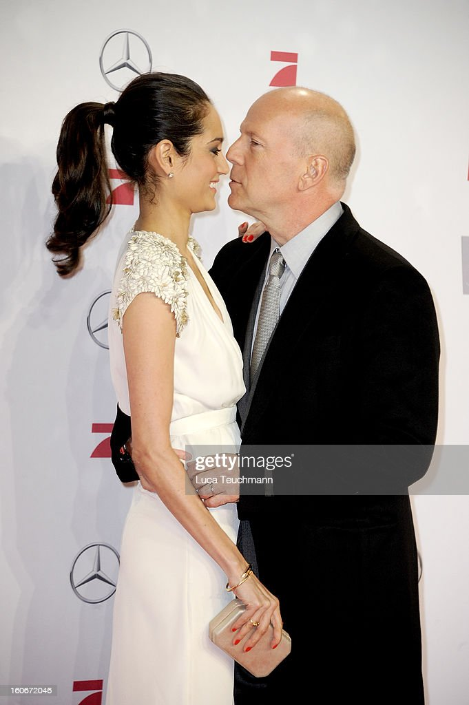 Emma Willis and <a gi-track='captionPersonalityLinkClicked' href=/galleries/search?phrase=Bruce+Willis&family=editorial&specificpeople=202185 ng-click='$event.stopPropagation()'>Bruce Willis</a> attend the premiere of 'Die Hard - Ein Guter Tag Zum Sterben' at Sony Center on February 4, 2013 in Berlin, Germany.