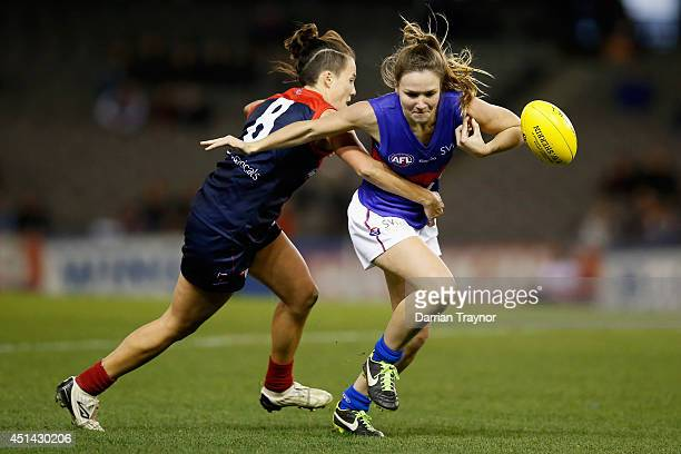 Emma Zielke of Melbourne tackles Emily Bates of the Western Bulldogs during the women's exhibition AFL match between the Western Bulldogs and the...