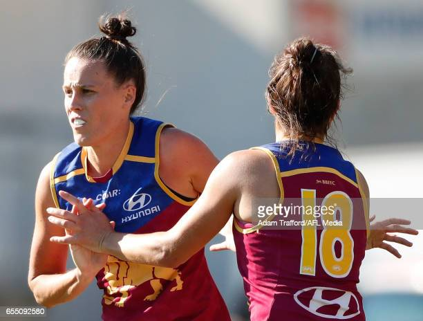 Emma Zielke of the Lions celebrates with Alexandra Anderson of the Lions during the 2017 AFLW Round 07 match between the Carlton Blues and the...