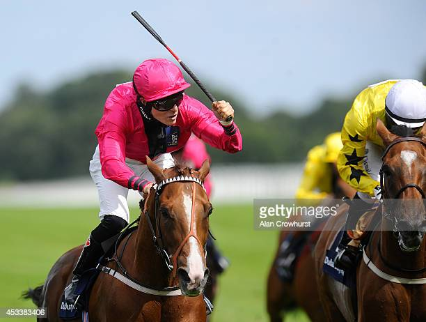 EmmaJayne Wilson of Canada riding Don't Call Me win The Dubai Duty Free Shergar Cup Mile at Ascot racecourse on August 09 2014 in Ascot England
