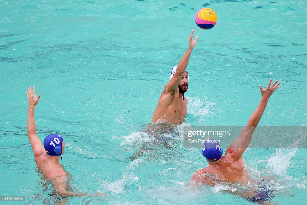 Emmanouil Mylonakis of Greece passes the ball against Denes Varga of Hungary and Krisztian Manhercz of Hungary during Men's Preliminary Round Group A...